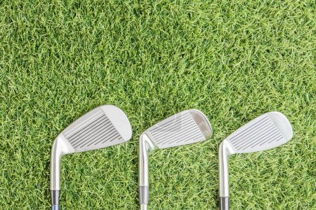 Row of golf club on grass