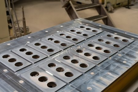Metal molds for production of bricks, close-up