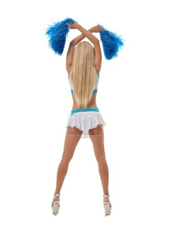 Rear view of leggy cheerleader with pom-poms