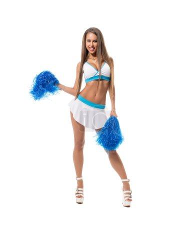 Photo pour Cheerleading. Image de la brune sexy qui posent avec pompons - image libre de droit