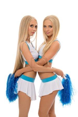 Photo pour Blondes séduisantes posant en uniforme de pom-pom girl. Isolé sur blanc - image libre de droit