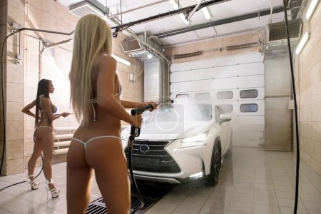 Image of sexy babes in bikini wash expensive car