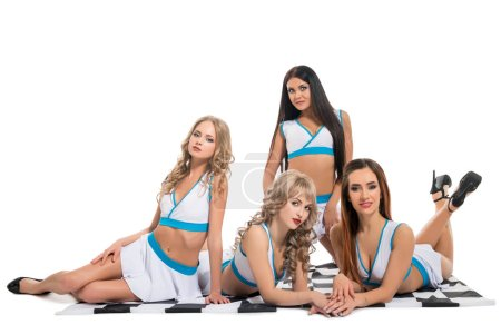 Sexy girls in formula one clothes sitting on flag
