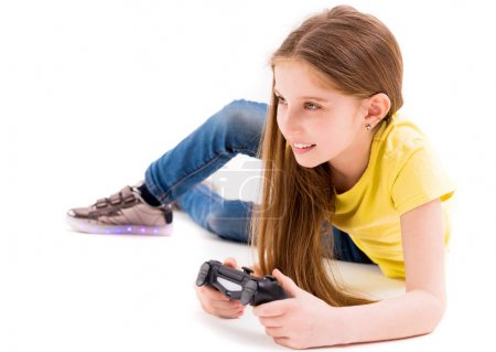 Photo for Concentrated and focused on winning a computer game girl, lying with a joystick - Royalty Free Image