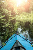 blue canoe on the river
