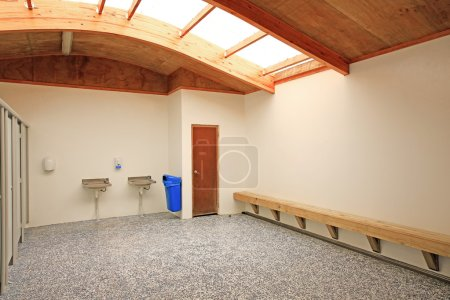 Interior of Waipu toilets with painted murals on outside walls