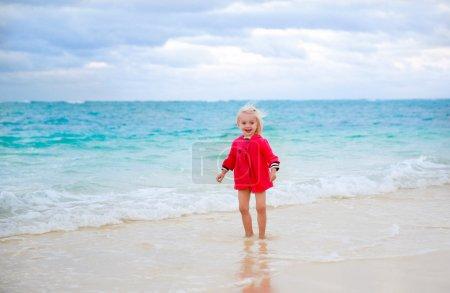 Little girl in red rain