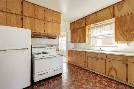 Interior of old fashioned kitchen room with linoleum floor