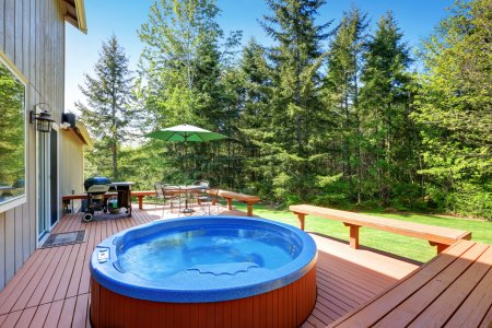 House backyard with hot tub, barbecue and patio table set