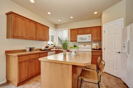 American Classic style kitchen interior with tile flooring