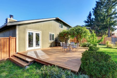 Back yard with pergola and wooden walkout deck