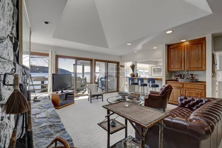 Beautiful living room with wet bar and doors to deck