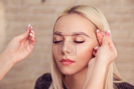 Microblading, micropigmentation eyebrows work flow in a beauty salon.
