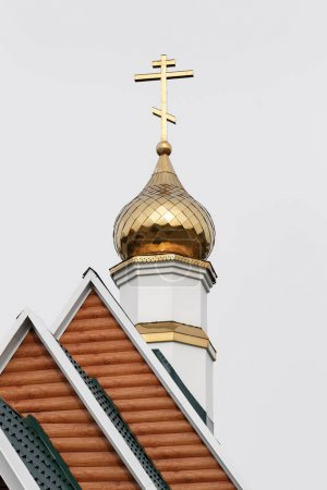 Dome with an Orthodox cross on roof of Temple in Honor of Saint Sergius of Radonezh of Kamchatka Diocese of Russian Orthodox Church