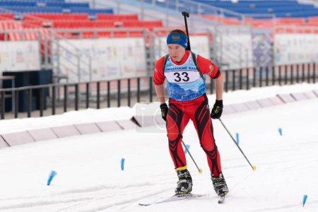 Photo for Kamchatka sportsman biathlete Sadykov Renat skiing on distance biathlon stadium. Open regional youth biathlon competitions East Cup. Petropavlovsk-Kamchatsky City, Kamchatka Peninsula, Russian Far East - April 12, 2019 - Royalty Free Image