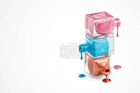 Nail polish dripping from bottles