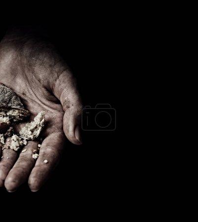Beggar Hands holding rusks