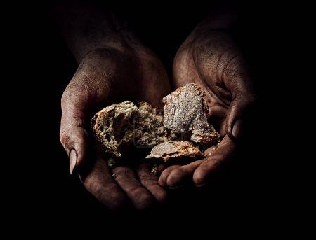 Hands of beggar with bread