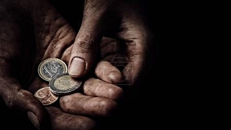 Photo for Beggar hands with few coins close up. Poverty concept - Royalty Free Image