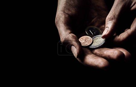 beggar holding coins