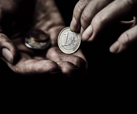Beggar hands with coins