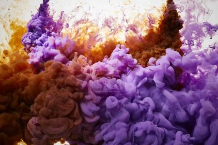orange and purple ink drops