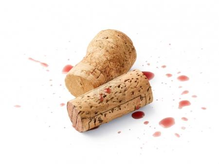 Spilled red wine with corks