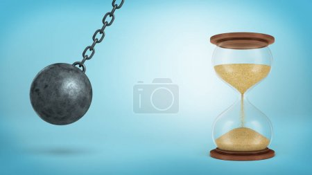 3d rendering of a iron wrecking ball swings on a chain ready to hit a large half-full hourglass on blue background.