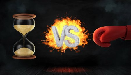3d rendering of a concrete letters VS caught on fire between an hourglass and a red boxing glove.