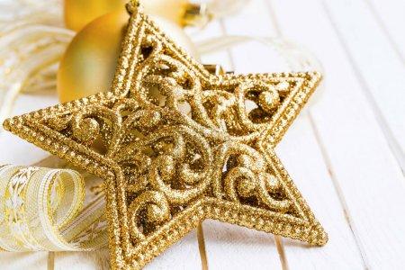 Festive golden glitter star decoration for Christmas tree