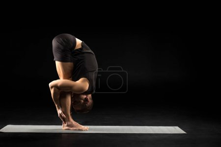 Man standing in yoga position