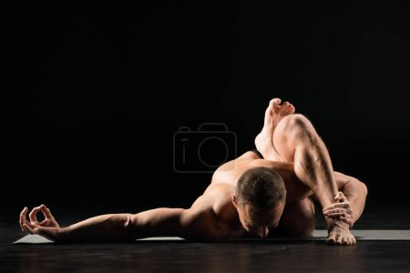 Man sitting in yoga position