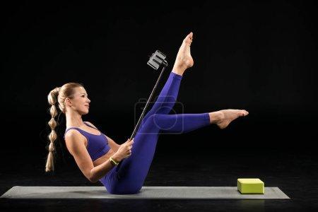 Yoga woman taking selfie