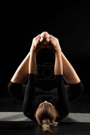 Woman lying in yoga position