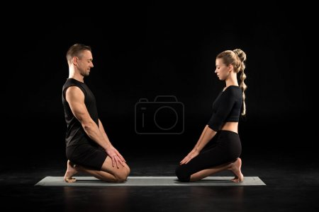 Yoga pacticing couple