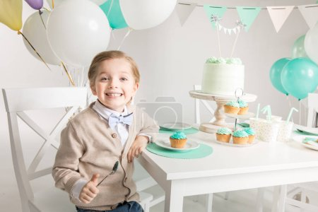 Boy sitting at festive table