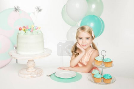 Girl with birthday sweets