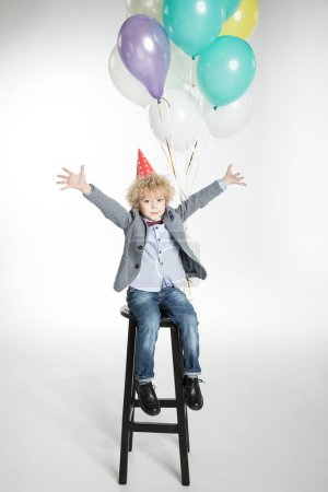 Boy with air balloons