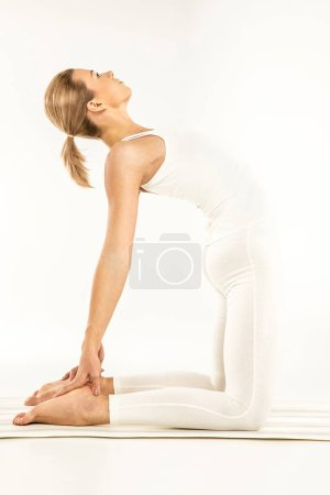 Photo for Woman practicing yoga standing in Ushtrasana position or Camel pose  isolated on white - Royalty Free Image