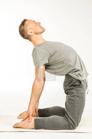Man standing in yoga pose
