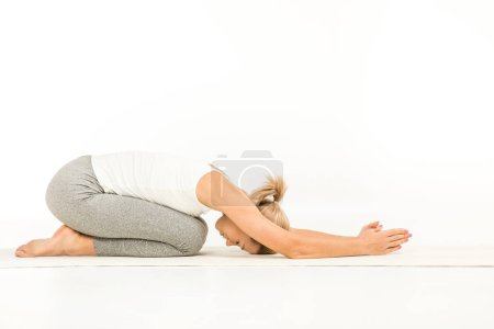 Photo pour Woman practicing yoga sitting in mudrasana pose isolated on white - image libre de droit