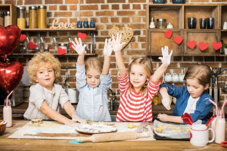 Children cooking biscuits