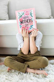 Boy with happy mothers day card
