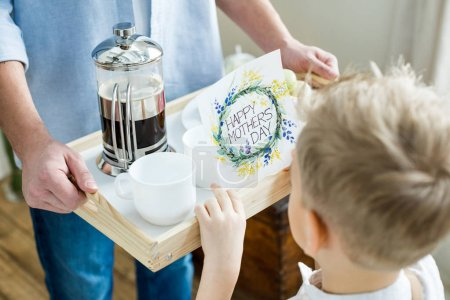 Photo for Partial view of father and son holding tray with coffee and happy mothers day greeting card - Royalty Free Image