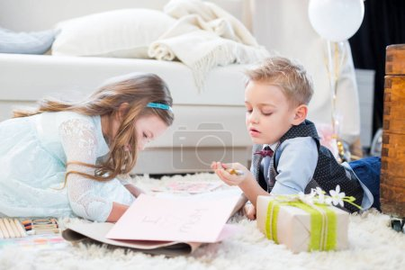 Siblings preparing present