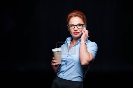 Businesswoman talking on smartphone