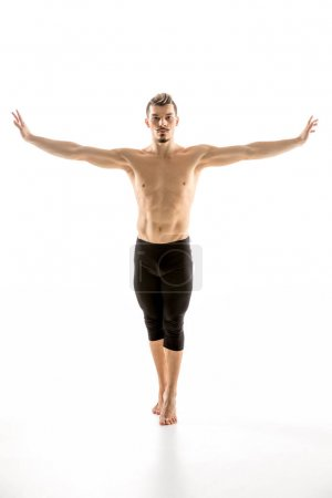 Photo for Young shirtless man contemporary dancer posing and looking at camera  isolated on white - Royalty Free Image