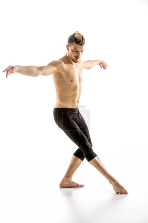 Photo for Young shirtless man performing contemporary dance position  isolated on white - Royalty Free Image