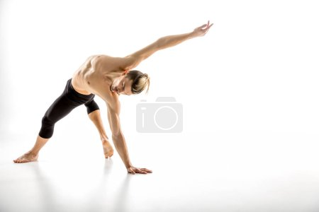 Photo for Young handsome shirtless man performing dance movement  isolated on white - Royalty Free Image