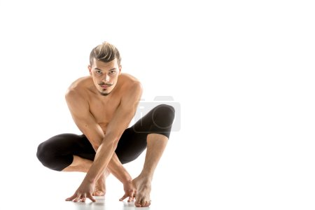 Photo for Young athletic shirtless male dancer posing and looking at camera  isolated on white - Royalty Free Image